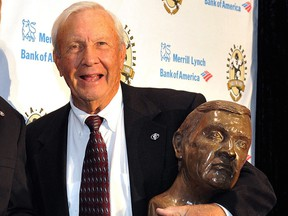 Pat Dye poses with his busts after an induction ceremony at the Georgia-Florida Hall of Fame on Oct. 31, 2014, in Jacksonville,Fla.