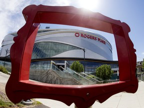 Rogers Place is framed by part of a public sculpture titled Still Life by Studio F-Minus, in Edmonton on Monday June 8, 2020. The ice has been put back in at Roger Place and will be available to members of the Edmonton Oilers for voluntary on-ice sessions.