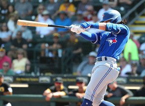 Toronto Blue Jays shortstop Bo Bichette (11) hits a home run during the fifth inning against the Pittsburgh Pirates at LECOM Park on Marsh 12, 2020.