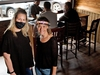 Garrison Pub general manger Shannon Roy, left and server Alexis Cooley were photographed in the pub for a story on how small businesses in Calgary are doing after being open for a couple of weeks. They were photographed on Monday, June 8, 2020.  Gavin Young/Postmedia