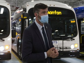 Mayor Don Iveson wears a mask during an announcement on the launch of the city's first batch of electric buses last week at the Kathleen Andrews Transit Garage.