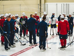 Winnipeg Jets coach Paul Maurice, centre, talks to his team at the Downtown Community Arena in Edmonton on Monday, July 27, 2019.