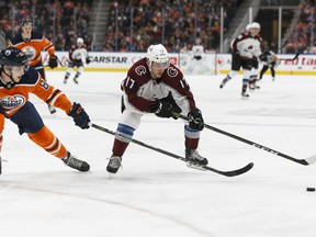 Edmonton Oilers' Matt Benning (83) reaches for Colorado Avalanche's Tyson Jost (17) at Rogers Place in this file photo taken Feb. 22, 2018.