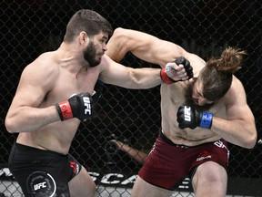 Tanner Boser, left, takes on Philipe Lins of Brazil  during UFC Fight Night at the UFC APEX on June 27, 2020.