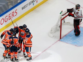 Edmonton Oilers players celebrate forward Alex Chiasson's third-period goal on Chicago Blackhawks goalie Corey Crawford on Aug. 3, 2020, during Game 2 of their Stanley Cup Playoffs qualifying series.