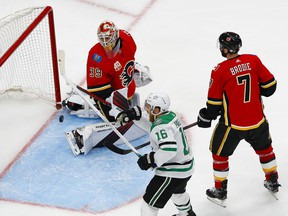 Dallas Stars center Joe Pavelski (16) celebrates a goal scored by Denis Gurianov (not pictured) against Calgary Flames goaltender Cam Talbot (39) as defenceman TJ Brodie (7) looks on during the third period in Game 6 of the first round of the 2020 Stanley Cup Playoffs at Rogers Place on Thursday, Aug. 20, 2020.
