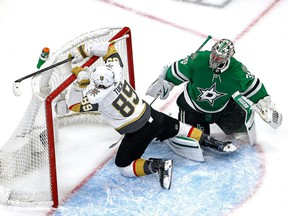 Alex Tuch #89 of the Vegas Golden Knights collides with the goal against Anton Khudobin #35 of the Dallas Stars during the second period in Game 4 of the Western Conference Final during the 2020 NHL Stanley Cup Playoffs at Rogers Place on September 12, 2020.