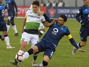 York 9 midfielder Manuel Apricio (10) battles for the ball with FC Edmonton defender Ramon Soria Alonso (5) in this file photo from June 5, 2019.