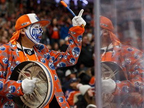 A fan cheers at Rogers Place as the Edmonton Oilers play the visiting Carolina Hurricanes during NHL action on Dec. 10, 2019.