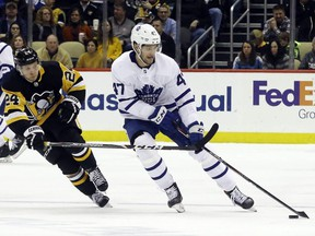 Toronto Maple Leafs left wing Pierre Engvall (47) skates with the puck against pressure from Pittsburgh Penguins center Dominik Kahun (24) during the third period at PPG PAINTS Arena on Feb. 18, 2020.
