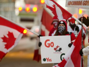 Team Canada fans cheer on the team outside Rogers Place prior to the start of the gold-medal game against Team USA at the IIHF world junior championship in Edmonton on Tuesday, Jan. 5, 2021.