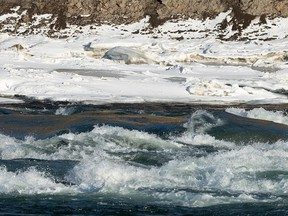 Water runs over ice making rapids in the North Saskatchewan River in Edmonton, on Thursday, Jan. 14, 202. Edmonton Fire Rescue Services are reminding Edmontonians to stay off the river as they have responded to seven river rescue calls in the last two weeks, an almost 50 per cent increase in call volume year-over-year. Photo by Ian Kucerak