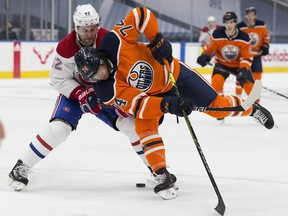 Edmonton Oilers Ethan Bear (74) and Montreal Canadiens Jonathan Drouin (92) battle for the puck during second period NHL action on Saturday, Jan. 16, 2021 in Edmonton.