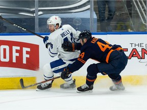 Edmonton Oilers forward Zack Kassian (44) battles Toronto Maple Leafs defenceman Morgan Reilly (44) during first period NHL action at Rogers Place in Edmonton, on Thursday, Jan. 28, 2021.