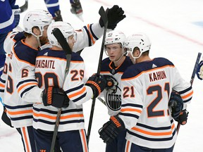 Edmonton Oilers forward Kailer Yamamoto (56) celebrates with teammates after scoring against the Toronto Maple Leafs at Scotiabank Arena on Wednesday, Jan. 20, 2021.