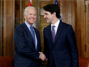 FILE PHOTO: Canada's Prime Minister Justin Trudeau (R) shakes hands with U.S. Vice President Joe Biden during a meeting in Trudeau's office on Parliament Hill in Ottawa, Ontario, Canada, December 9, 2016. REUTERS/Chris Wattie/File Photo ORG XMIT: FW1