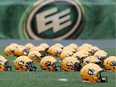 Helmets sit on the field during an Edmonton Football Team practice at Commonwealth Stadium in this file photo.
