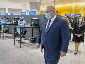 Ontario Premier Doug Ford walks through the COVID-19 testing centre in the International Arrivals section at Pearson Airport in Toronto on January 26, 2021.