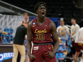 Aher Uguak (30) of the Loyola University Chicago Ramblers reacts after drawing a foul against the University of Illinois Fighting Illini in the second round of the 2021 NCAA tournament at Bankers Life Fieldhouse on March 21, 2021, in Indianapolis, Indiana.