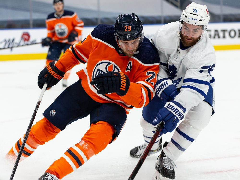 Edmonton Oilers centre Leon Draisaitl (29) battles Toronto Maple Leafs forward TJ Brodie (78) during third period NHL action at Rogers Place in Edmonton, on Wednesday, March 3, 2021.