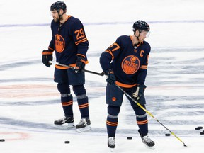 Edmonton Oilers Leon Draisaitl (29) and Connor McDavid (97) warm up before an NHL game against the Winnipeg Jets at Rogers Place in Edmonton on Saturday, March 20, 2021.