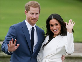 Prince Harry and Meghan Markle pose for a photograph in the Sunken Garden at Kensington Palace November 27, 2017.