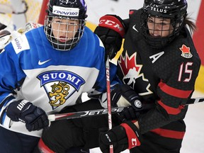 Nelli Laitinen (L) of Finland vies with Melodie Daoust of Canada during the semifinal match Finland v Canada at the IIHF Women's Ice Hockey World Championships in Espoo, Finland on April 13, 2019.
