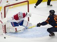 Edmonton Oilers captain Connor McDavid (97) reaches for the puck in front of Montreal Canadiens goalie Jake Allen (34) on Monday, April 19, 2021, in Edmonton.