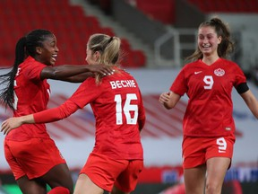 Canada's Nichelle Prince celebrates scoring their second goal with Janine Beckie (16) and Jordyn Huitema (9) against England at bet365 Stadium in Stoke-on-Trent, England, on April 13, 2021.