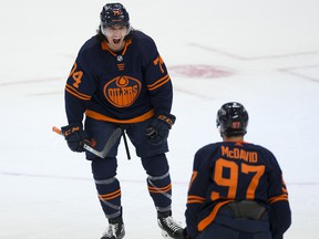 Edmonton Oilers defenceman Ethan Bear (74) celebrates his goal with teammate Connor McDavid (97) against the Montreal Canadiens on April 19, 2021, in Edmonton.
