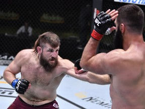 In this handout image provided by UFC, Tanner Boser, left, punches Andrei Arlovski of Belarus in a heavyweight fight during the UFC Fight Night event at UFC APEX on Nov. 07, 2020, in Las Vegas, Nevada.