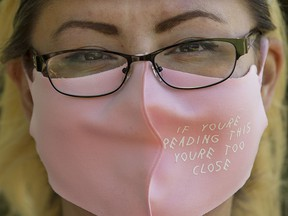 Blaire Preteau wears a face mask to protect against COVID-19 while working in Edmonton's Borden Park, Saturday June 12, 2021.