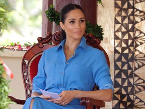 Meghan, Duchess of Sussex talks with students during a visit to Tupou College in Tonga on Oct. 26, 2018.