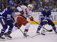 Carolina Hurricanes forward Warren Foegele (13) shoots the puck as Toronto Maple Leafs forward William Nylander (88) and defenseman Tyson Barrie (94) defend during the second period at Scotiabank Arena on Feb 22, 2020.
