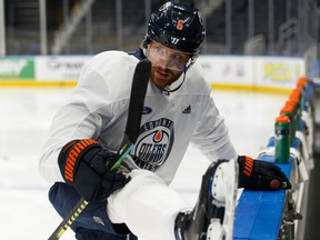 Adam Larsson (6) stretches during Edmonton Oilers practice at Rogers Place in Edmonton on March 6, 2020.