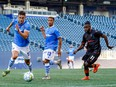 FC Edmonton striker Amer Didic (55) chases the loose ball as Christopher Nanco (11) of Forge FC defends at Investors Group Field in Winnipeg on July 1, 2021.