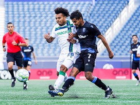 Cedric Toussaint of York United FC, left, and Shamit Shome of FC Edmonton battle for the ball in a Canadian Premier League match at Investors Group Field on July 24, 2021.