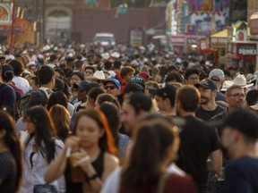 Crowd on the food booth alley on the midway at the Calgary Stampede on Tuesday, July 13, 2021. Mike Drew/Postmedia