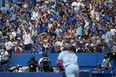 Fans watch as Vladimir Guerrero Jr. #27 of the Toronto Blue Jays hits a deep fly out against the Kansas City Royals during the eight inning of their MLB game at Rogers Centre on July 31, 2021 in Toronto.