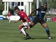Cavalry FC Mohamed Farsi (L) competes for the ball in the area during CPL soccer action between FC Edmonton and Cavalry FC in Calgary at Atco Field on Sunday, Aug. 29, 2021.