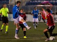FC Edmonton's Easton Ongaro (9) shoots past Calvary FC's Mason Trafford (5) during the second half of Canadian Premier League action at Clarke Stadium in Edmonton, on Wednesday, Sept. 1, 2021.