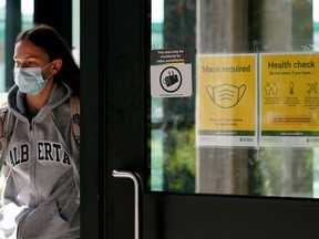 A student exits the Students Union Building at the University of Alberta in Edmonton on Thursday September 14, 2021.