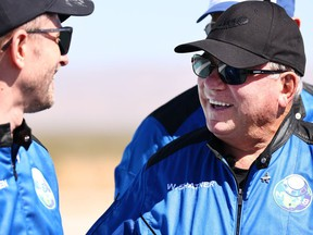 Star Trek actor William Shatner, right, smiles as Planet Labs co-founder Chris Boshuizen looks on during a media availability on the landing pad of Blue Origin's New Shepard after they flew into space on Oct. 13, 2021. near Van Horn, Texas. Shatner became the oldest person to fly into space on the 10-minute flight. They flew aboard mission NS-18, the second human spaceflight for the company which is owned by Amazon founder Jeff Bezos.