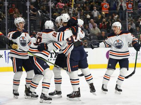 The Edmonton Oilers celebrate a first-period power-play goal by Zach Hyman #18 against the Vegas Golden Knights during their game at T-Mobile Arena on October 22, 2021 in Las Vegas, Nevada.