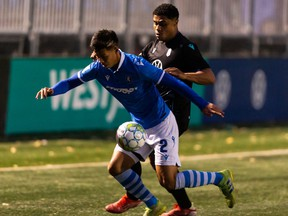 FC Edmonton's Paris Donald Gee (2) and Pacific FC's Terran Campbell (14) battle during first half Canadian Premier League action at Clarke Stadium in Edmonton, on Wednesday, Oct. 6, 2021.