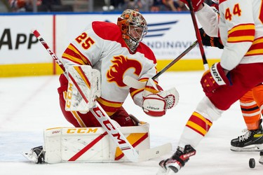 Calgary Flames' goaltender Jacob Markstrom (25) looks for a rebound during first period preseason NHL action versus the Edmonton Oilers at Rogers Place in Edmonton, on Monday, Oct. 4, 2021.