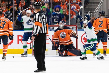 Vancouver Canucks' Oliver Ekman-Larsson (23) scores a goal on Edmonton Oilers' goaltender Mike Smith (41) during third period NHL action at Rogers Place in Edmonton, on Wednesday, Oct. 13, 2021.