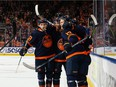 Edmonton Oilers' Connor McDavid (97) celebrates a goal with teammates on Calgary Flames goaltender Jacob Markstrom (25) during first period NHL action at Rogers Place in Edmonton, on Saturday, Oct. 16, 2021.