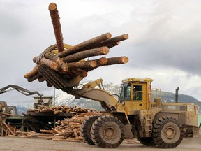 Logs are transported through a Tembec Inc. lumber yard in Canal Flats, British Columbia.