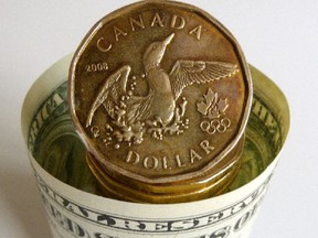 Earlier on Monday, the Canadian dollar touched $1.0240, matching Friday's high and the strongest level since Sept. 19, 2011.
